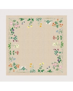 Linen tablecloth with flowers stitched along the perimeter of the tablecloth by traditional stitch. 6107