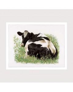 Tableau brodé. Vache noire et blanche allongée dans l'herbe. Thea Gouverneur G0452