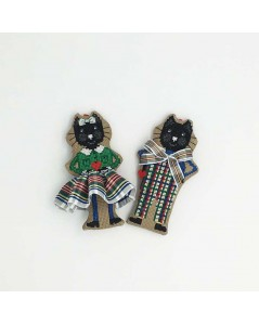 Couple of black cats in white-green tartans. Counted cross stitch embroidery suspensions.
