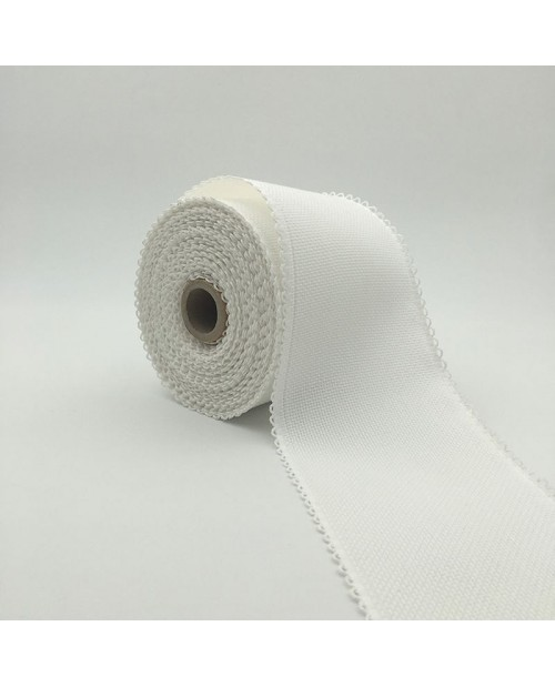 Roll of 7 points/cm Aida band. White cotton band, 10 cm large.