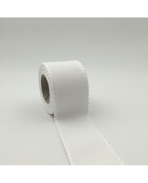 Roll of 6 points/cm Aida band. White cotton band 5 cm wide.