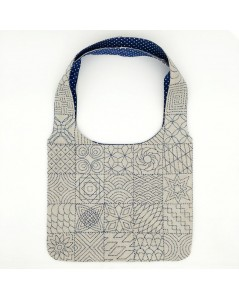 Handbag embroidered. Sashiko style embroidery on printed linen. To embroider and to sew. Design by Cecile Vessiere