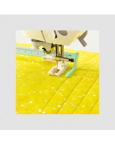 Sliding Stitch Guide Foot used to stitch parallel lines. Clover C7709