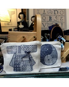 Two linen pochettes Sashiko style embroidery. Korean Kimono and Yin and Yang. Le Bonheur des Dames shop-window.