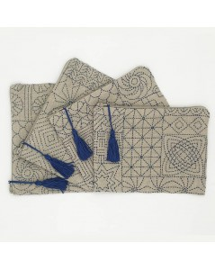 Linen pochettes embroidered by front stitch, printed motive, style Sashiko. Le Bonheur des Dames